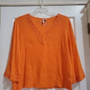 Orange flowing blouse with a little sparkle